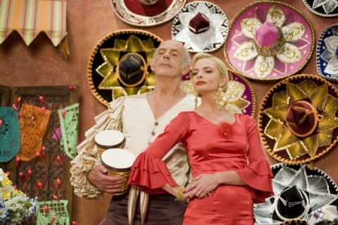 Christopher Lloyd and Jaime Pressly share a dance in 'The Oogieloves'.