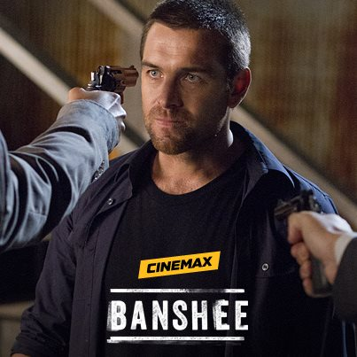 Antony Starr stares down the barrel of a loaded gun in 'Banshee'.